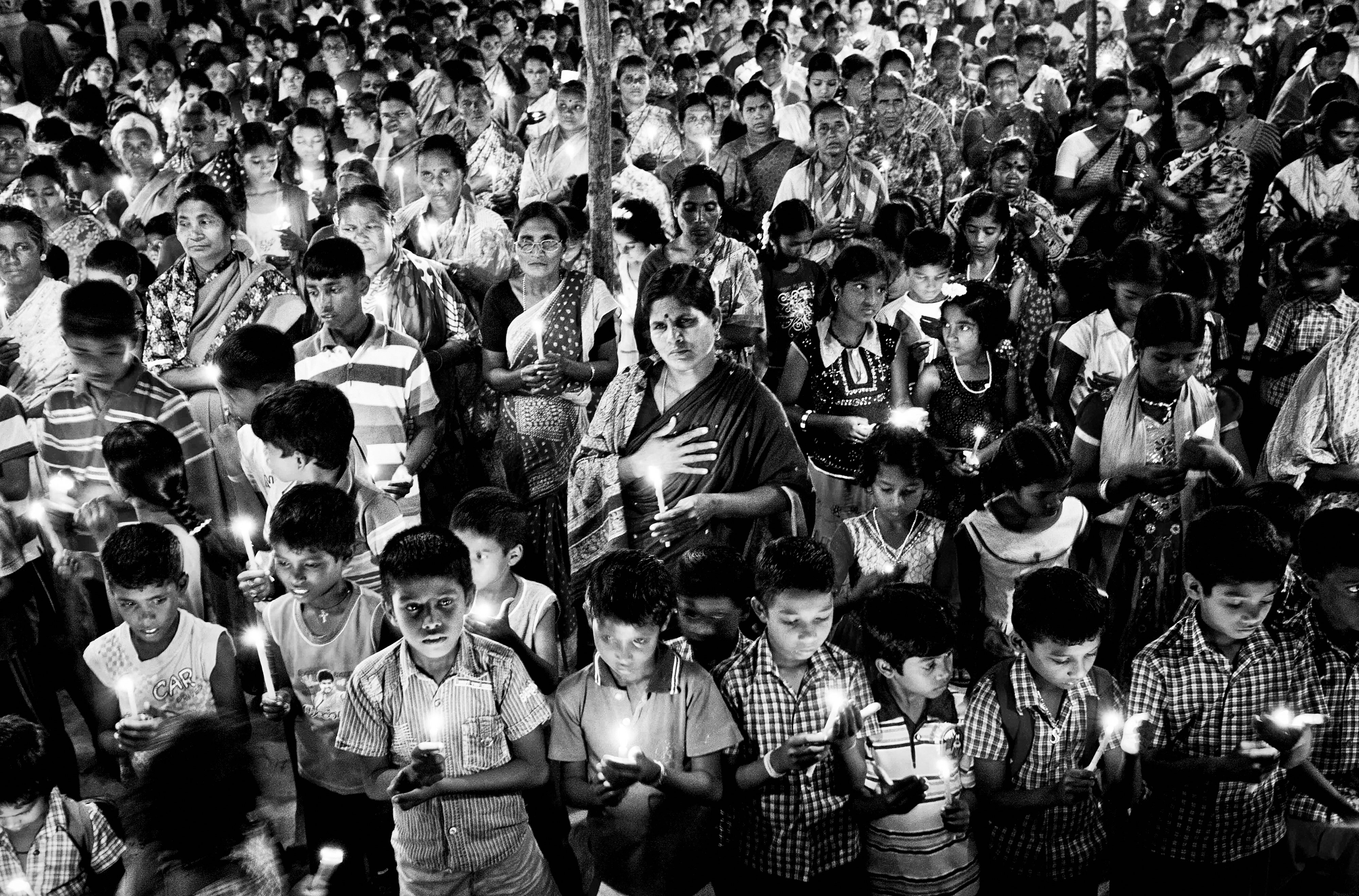 Villagers observe a candle light vigil to pay homage to Hiroshima victims on Hiroshima Day.