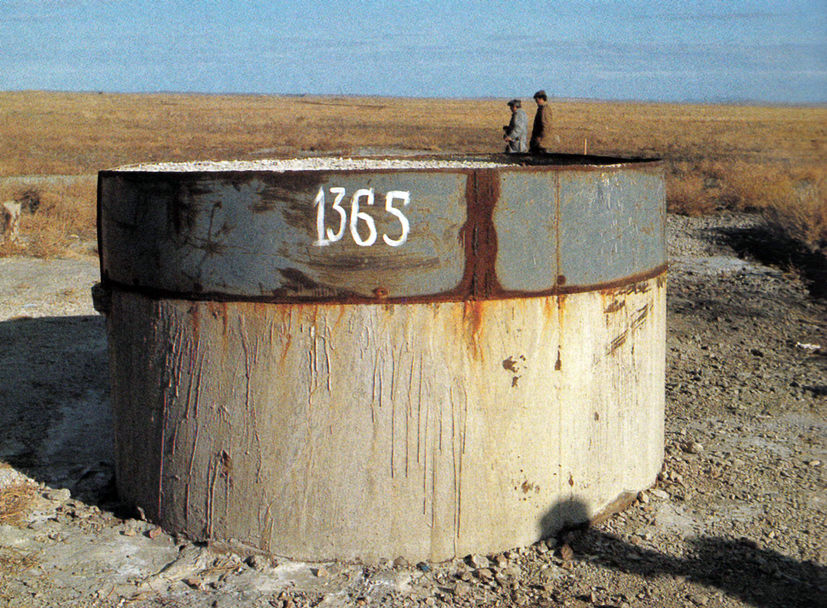"""The mark 1365 on the test site of the nuclear area is not just a number, but a historical landmark in the life of the testing area and its people. """"1365"""" means the number engraved on the concrete stopper of the well of the last nuclear explosion conducted at the Semipalatinsk testing area on the 19th of October, 1991."""