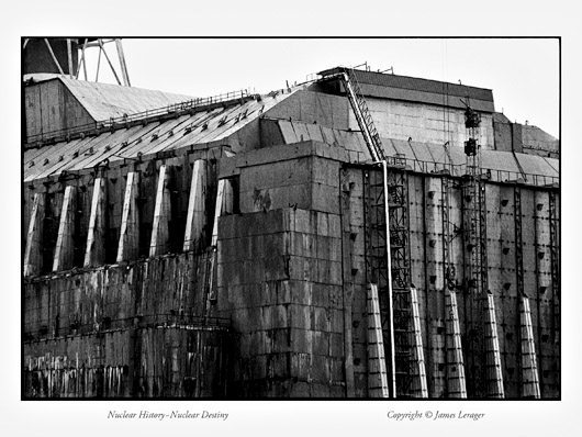 The Chernobyl Sarcophagus, built with the labor of 600,000 people and originally intended to stand for decades, was already buckling and disintegrating five years after construction was completed in 1987. Now in danger of collapsing, it is to be superseded by a much larger structure—arching over the entire reactor building and original sarcophagus—to be constructed by an international consortium at a cost estimated in 2004 at $800 million. Inside the cracking sarcophagus, the destroyed building still contains large quantities of the reactor's radioactive materials.
