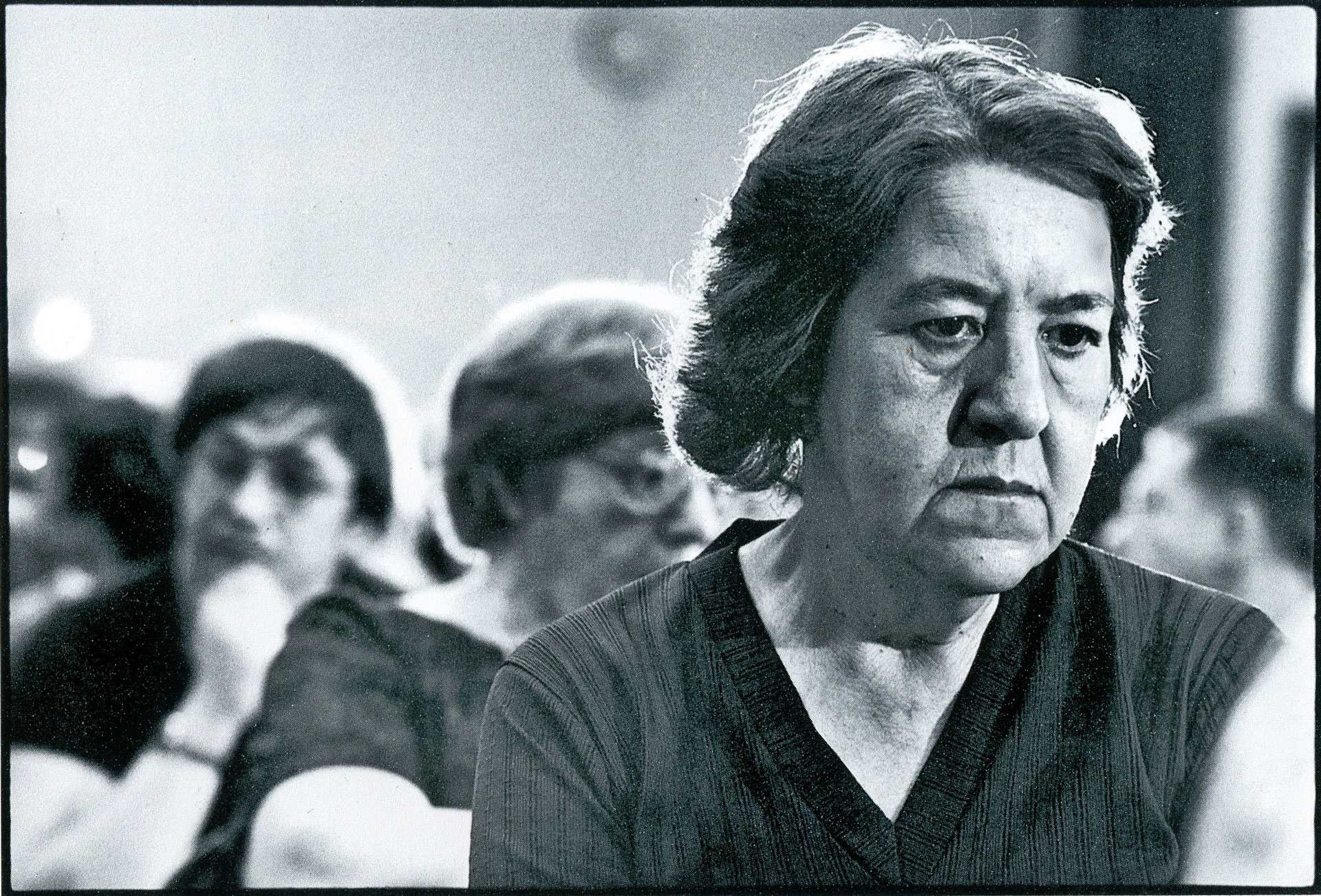 Woman ponders at a Public Meeting in Middletown